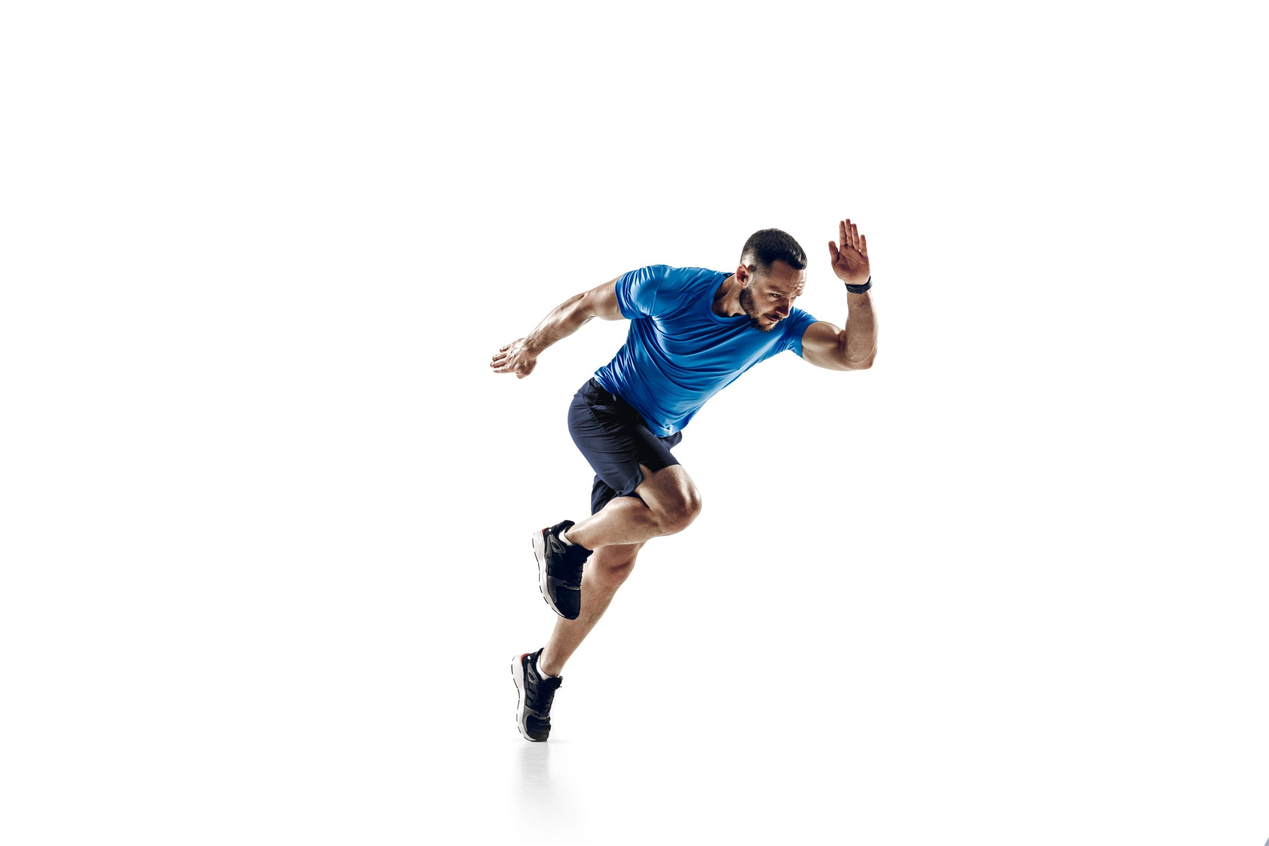 Caucasian professional male runner, athlete training isolated on white studio background. Copyspace for ad.